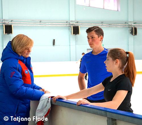 Russia's Anastasia Mishina and Aleksandr Galliamov with coach Liudmila Velikova